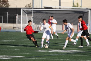 PHOTO COURTESY OF ELLIOT SMITH-HASTIE  Senior Elliot Smith-Hastie maneuvers through the Artesia High School defense in a 2-0 win on Tuesday, Dec. 1. Smith-Hastie will play soccer for Boston College next year.