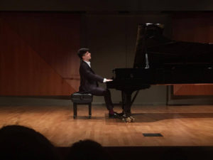 "SENIOR WILLIAM CALIX plays George Gershwin's ""Rhapsody in Blue,"" Claude Debussy's ""Clair de Lune"" and Eugene Bozza's ""Aria"" for his senior recital."