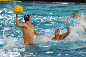 Freshman attacker Carson Kranz prepares to launch the ball down the pool towards his other teammates and the goal. The team fell short of a championship victory in the semi-finals 5-9.