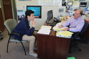 SENIOR KIERAN MOUTES-LEE consults counselor Geoffrey Joy for college advice as the Jan. 1 application deadline for many colleges rapidly approaches.