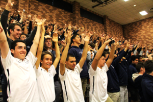 MEMBERS OF THE STUDENT BODY commemorate the start of the winter sports season with an Icelandic war chant.